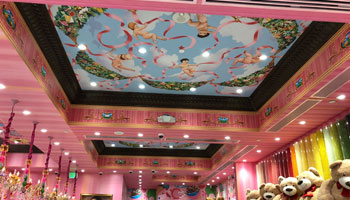 Beautiful Sistine chapel style ceiling illuminated by recessed lighting.