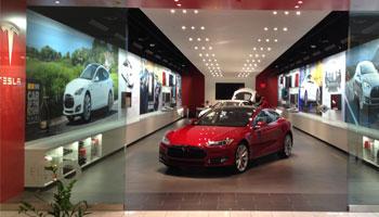 Tesla showroom brightened by recessed lighting.