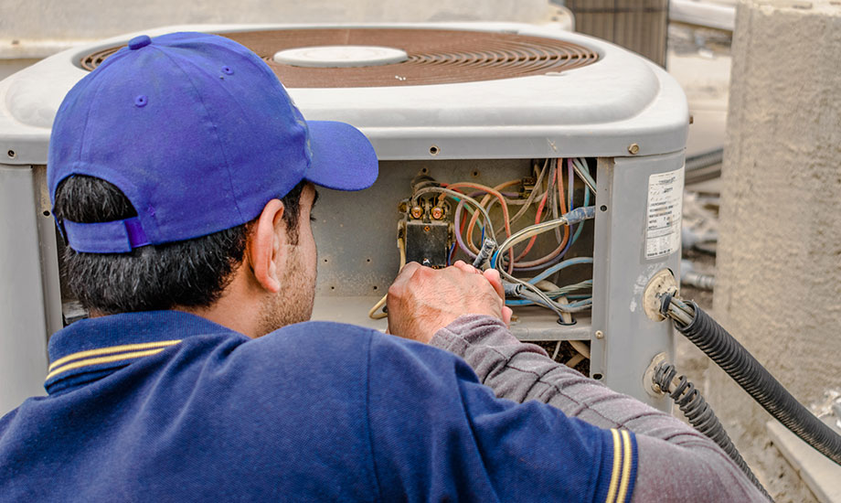 electrician fixing unit of an air conditioner