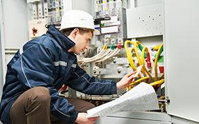 electrician inspecting cabling of high voltage
